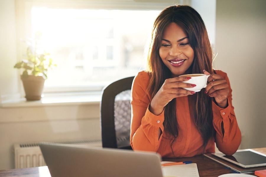 Woman sitting at desk viewing laptop